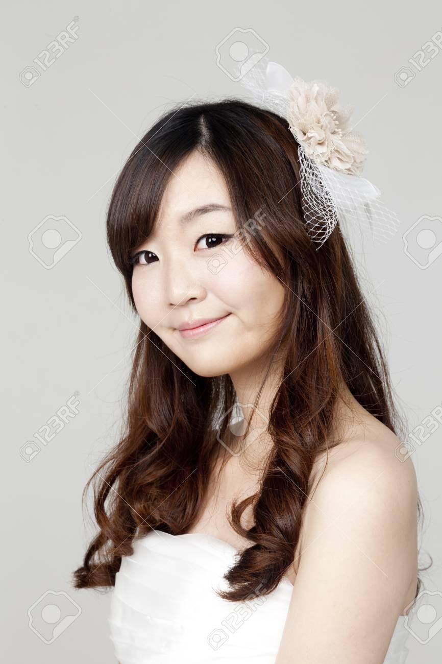 Beautiful girl dressed in white short dress Stock Photo - 14357710