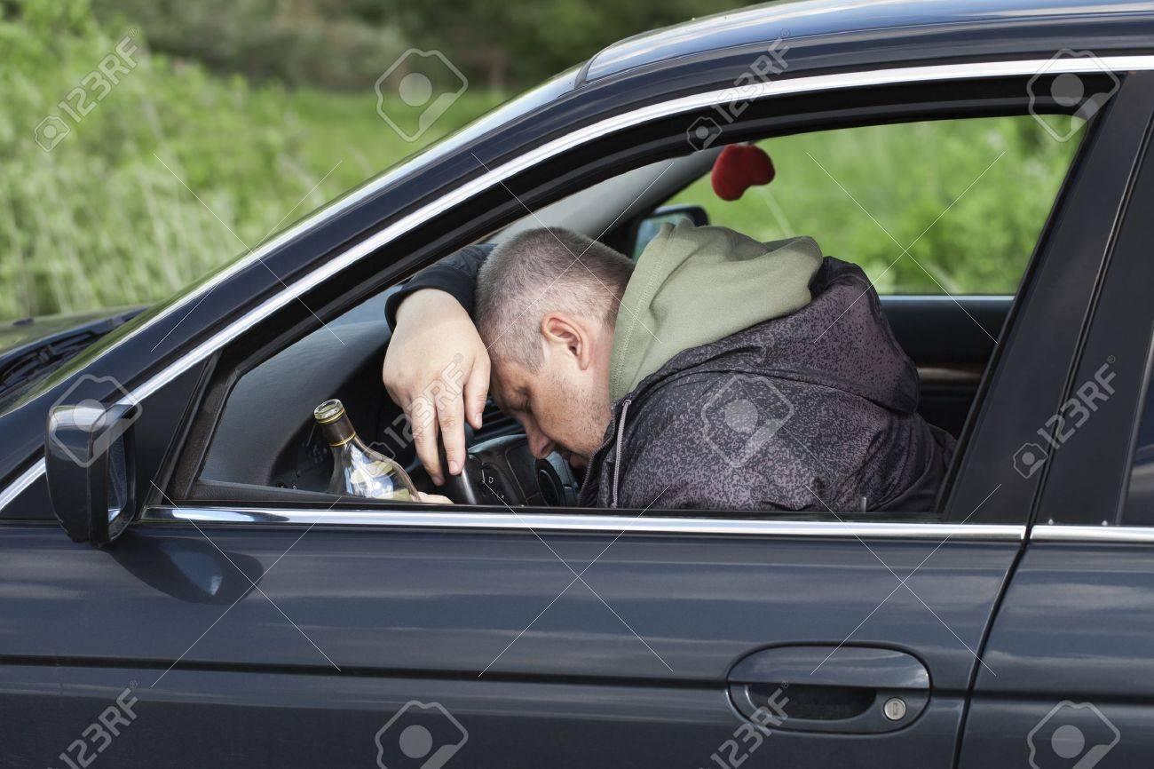 Drunk man asleep at the wheel Stock Photo - 14019172