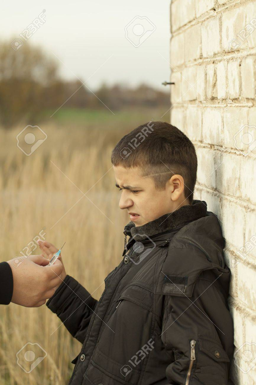 Somebody offers the syringe with the drug dose Stock Photo - 16036723