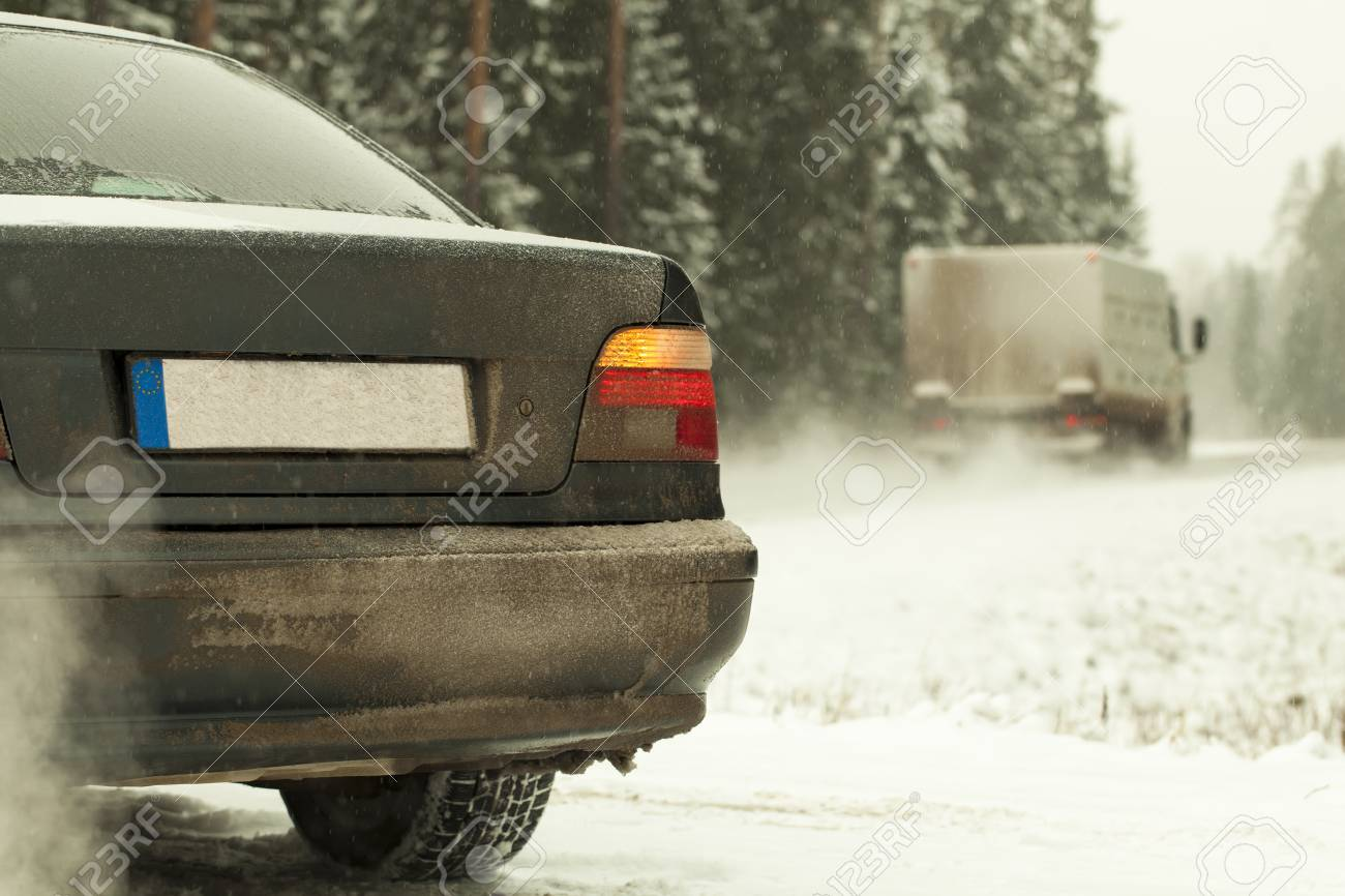 Car is going to turn on the highway in snowfall Stock Photo - 16853102