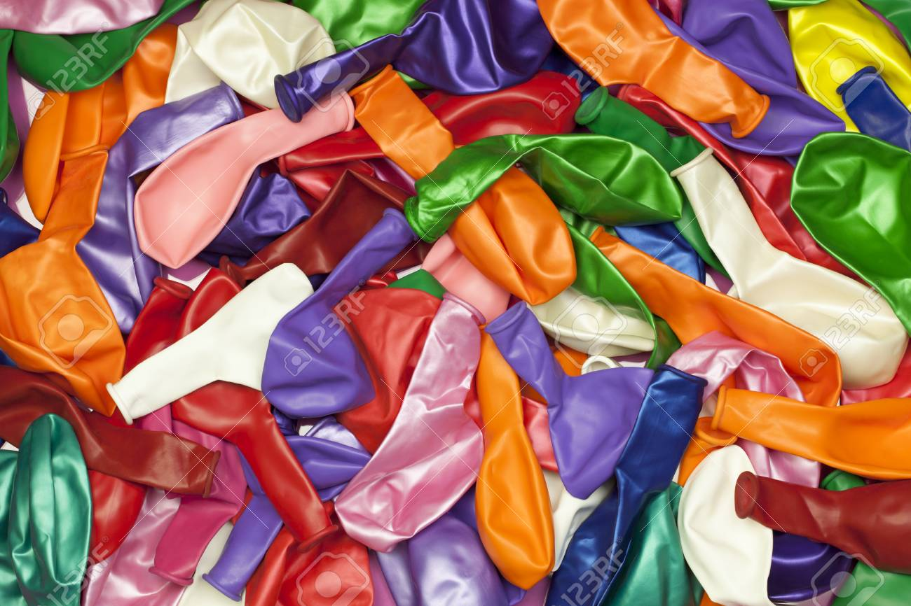 Different colored balloons stacked in pile Stock Photo - 17094342