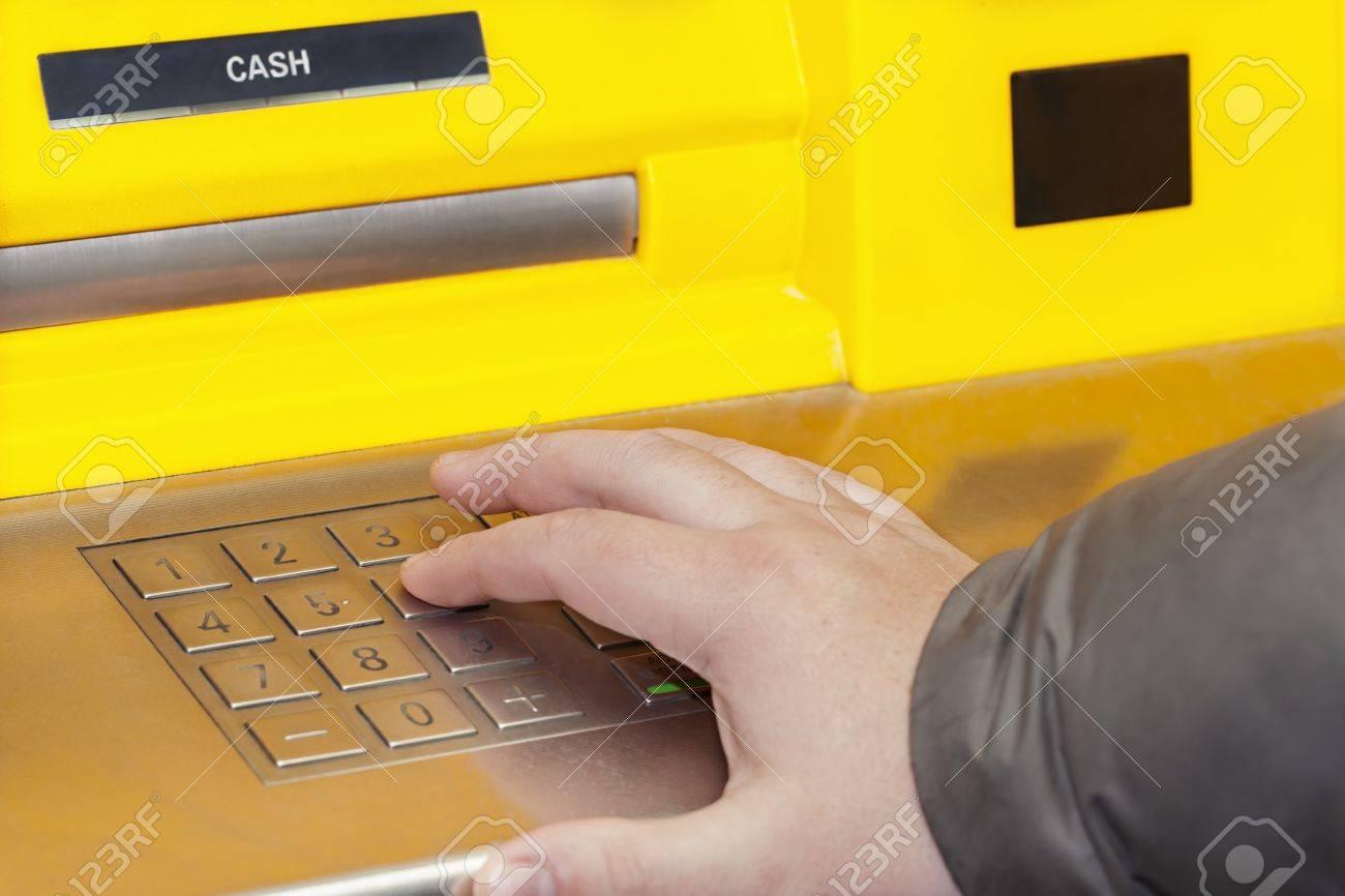 Man s hand near the cash machine on the pin code Stock Photo - 17094348