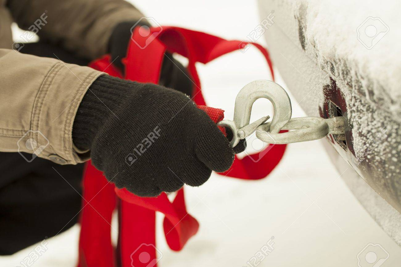 Man keep towing rope with hook near car Stock Photo - 17342486