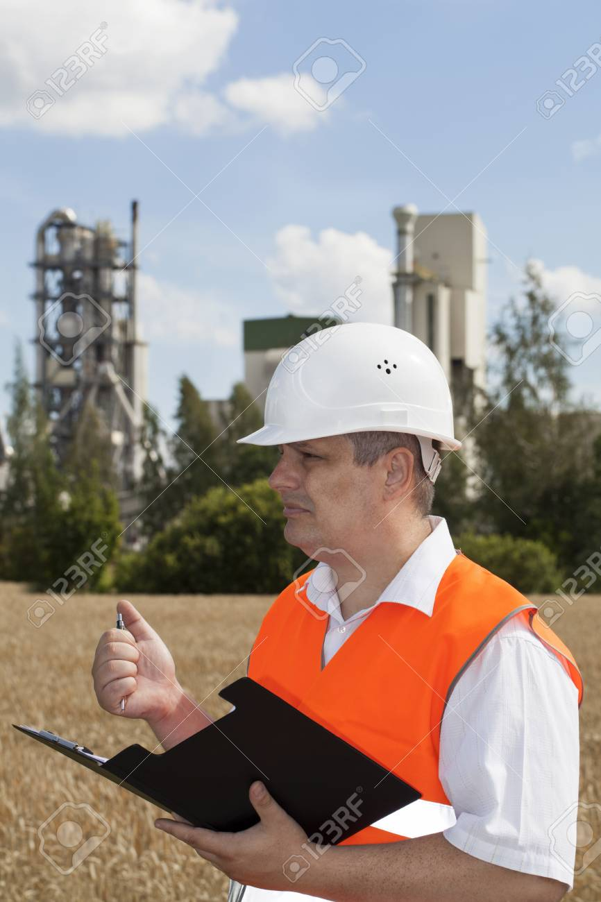 Engineer with folder near the factory Stock Photo - 17563456