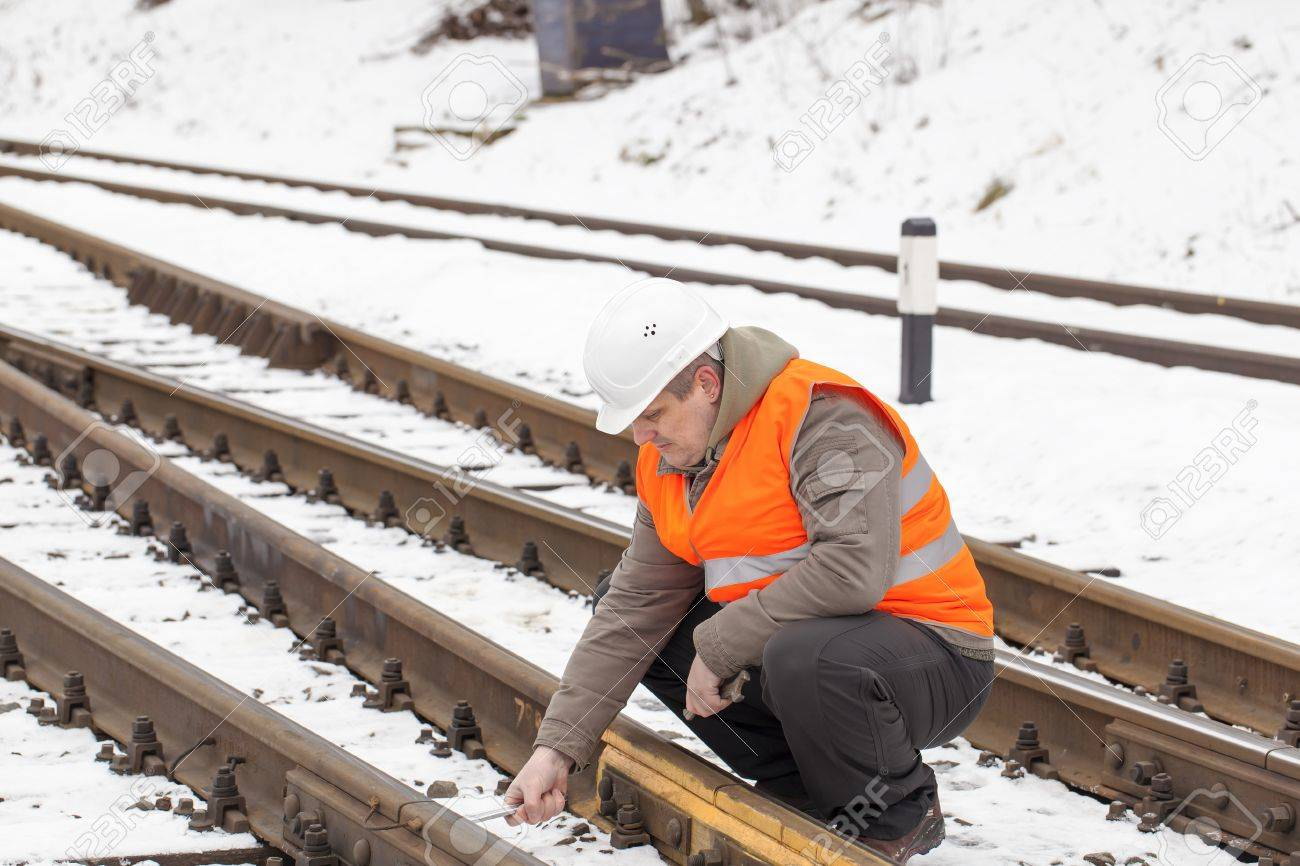 Railroad worker with adjustable wrench in the hand Stock Photo - 17753222