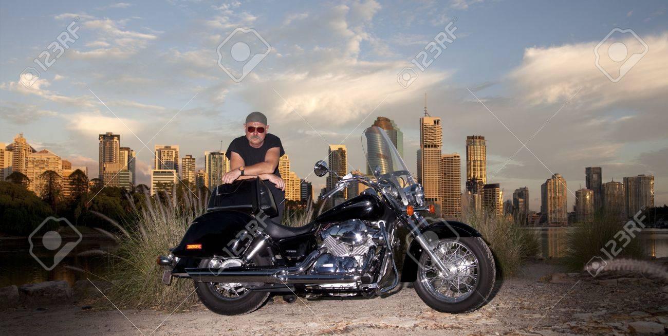 Bike rider with city backround Stock Photo - 6512293