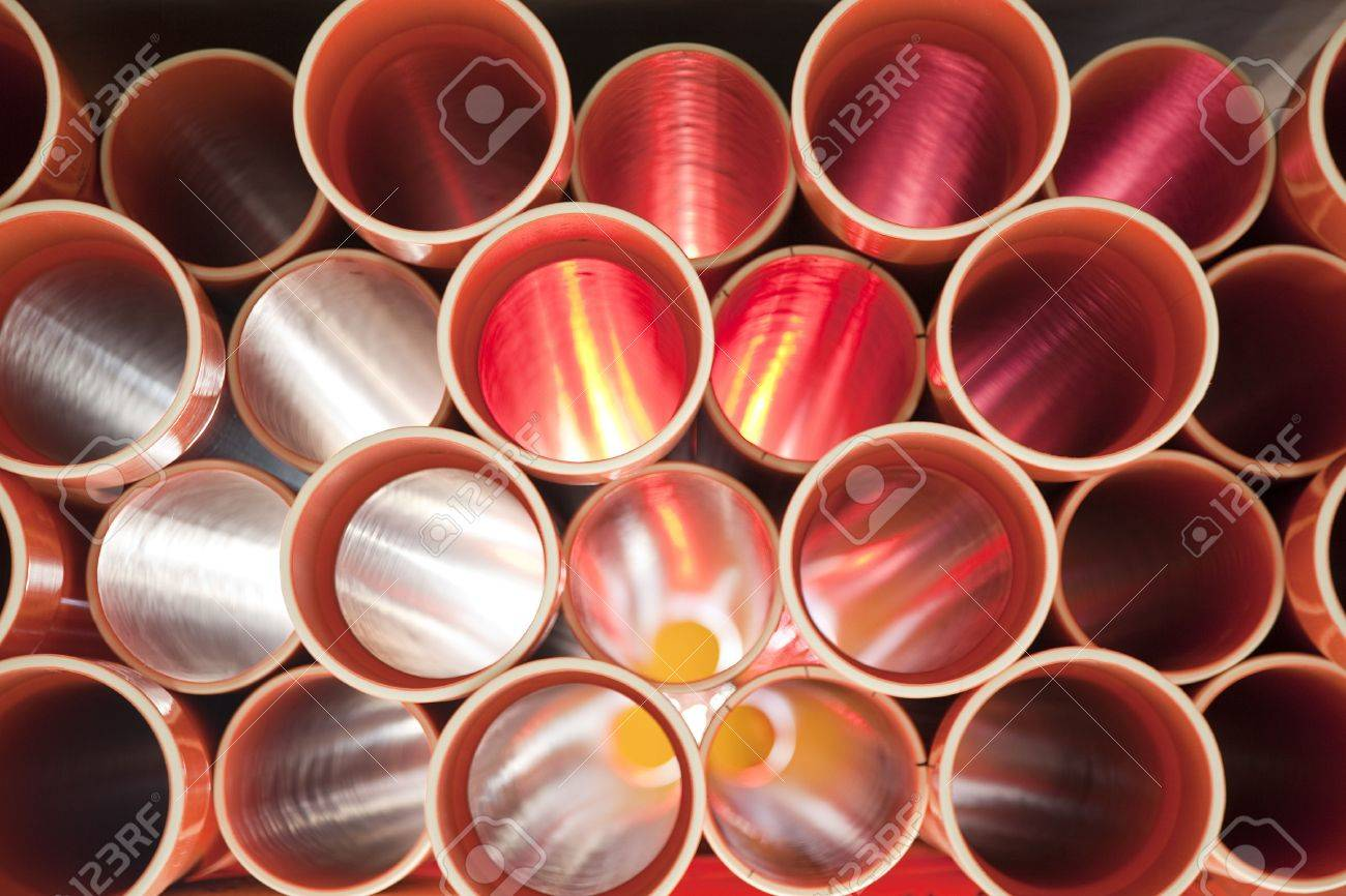 Brown PVC pipes stacked in construction site Stock Photo - 7607250