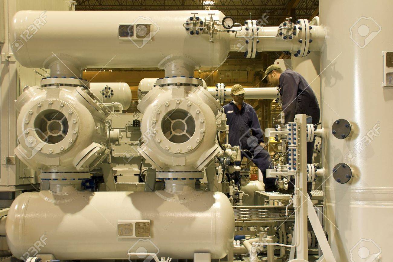 Natural gas compressor station with two working technicians Stock Photo - 13051721