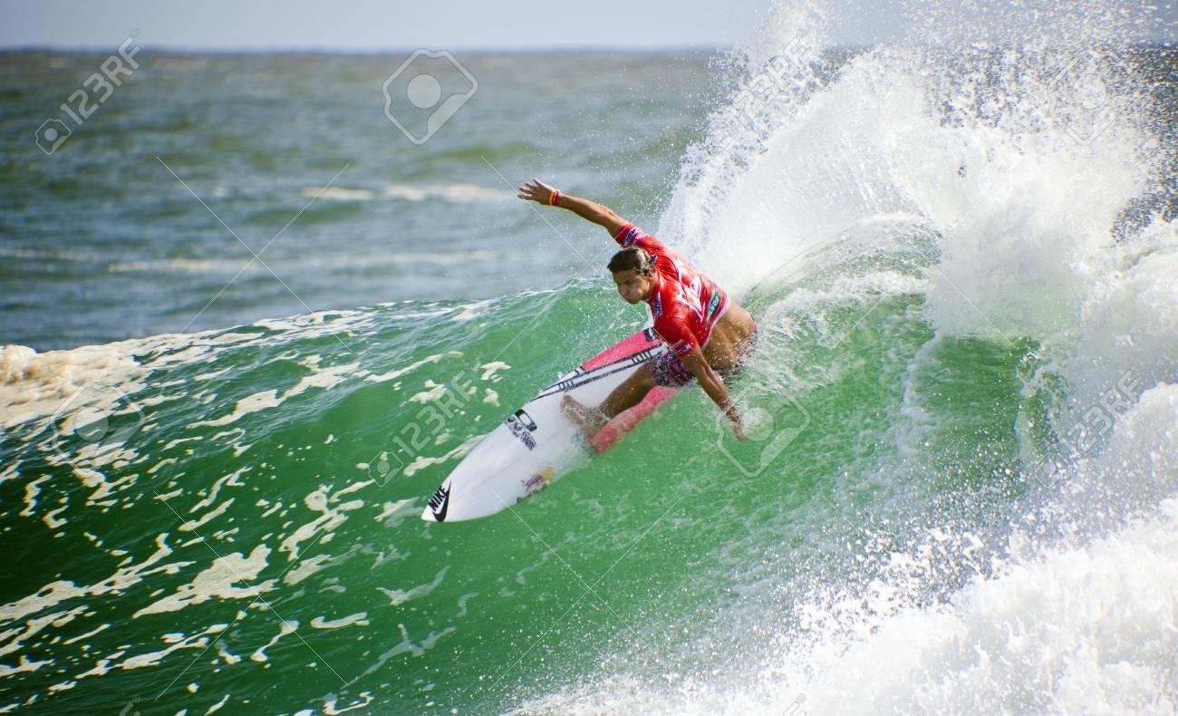 SNAPPER ROCKS, GOLD COAST, AUSTRALIA - FEB 26: Unidentified Surfer races the Quiksilver & Roxy Pro World Title Event. February 26, 2012, Snapper Rocks, Gold Coast, Australia  Stock Photo - 13061890