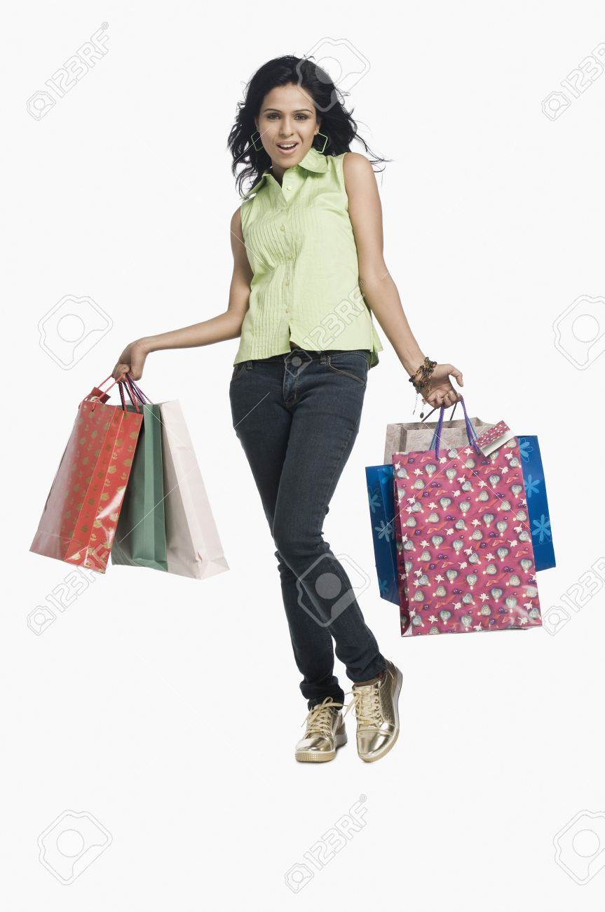 Woman Carrying Shopping Bags And Smiling Stock Photo, Picture And ...