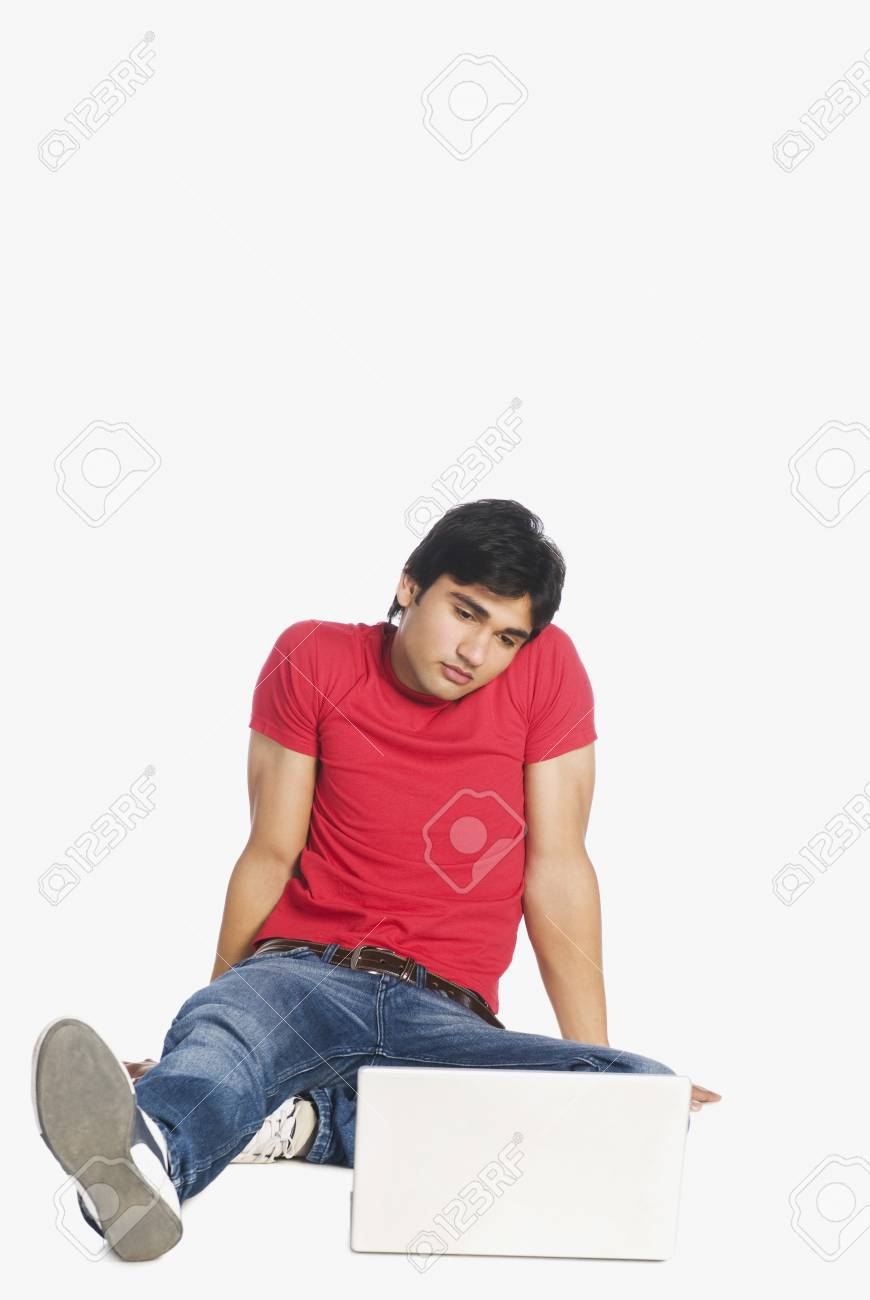 Man looking at a laptop Stock Photo - 10123424