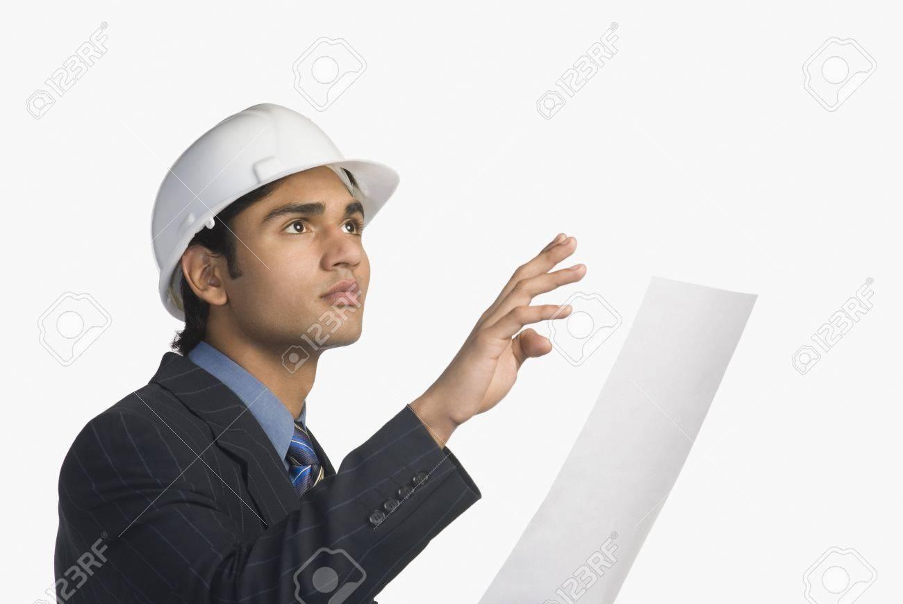 Architect holding a blueprint Stock Photo - 10123414
