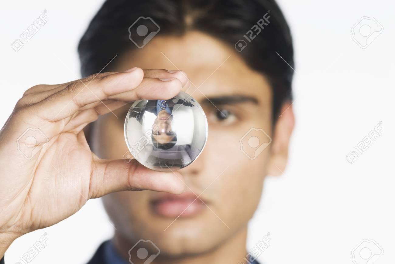 Businessman holding a crystal ball Stock Photo - 10126387