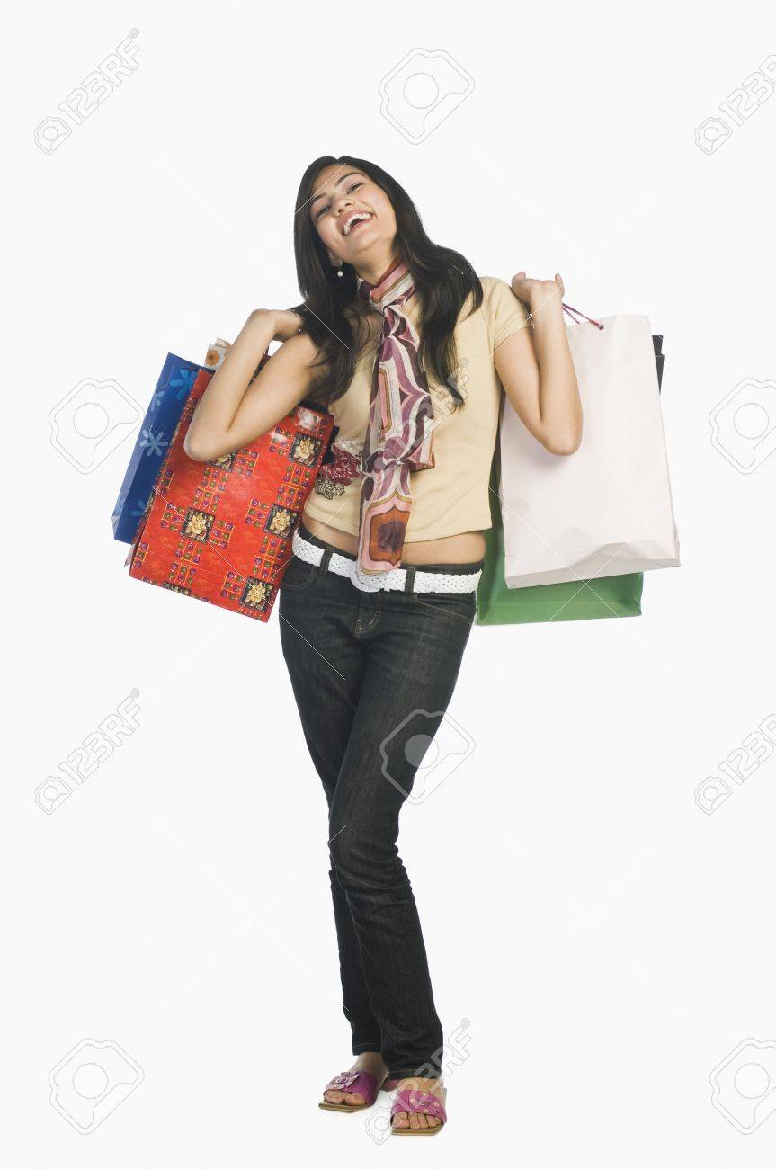 Woman carrying shopping bags and smiling Stock Photo - 10123393