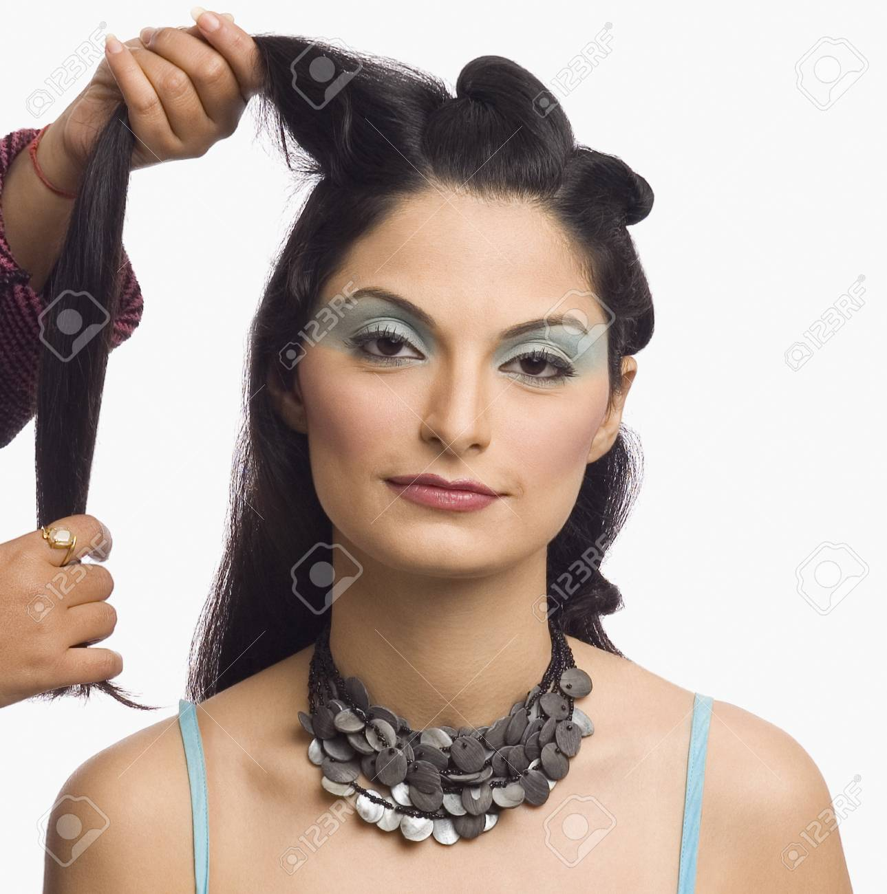 Person's hands styling a young woman's hair Stock Photo - 10123720