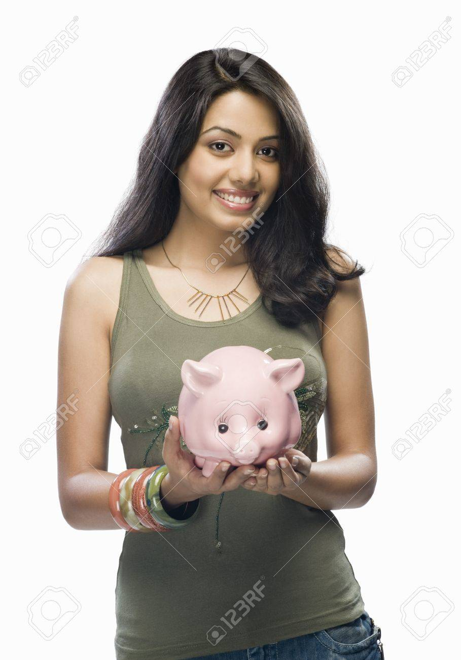 Portrait of a young woman holding a piggy bank Stock Photo - 10126147
