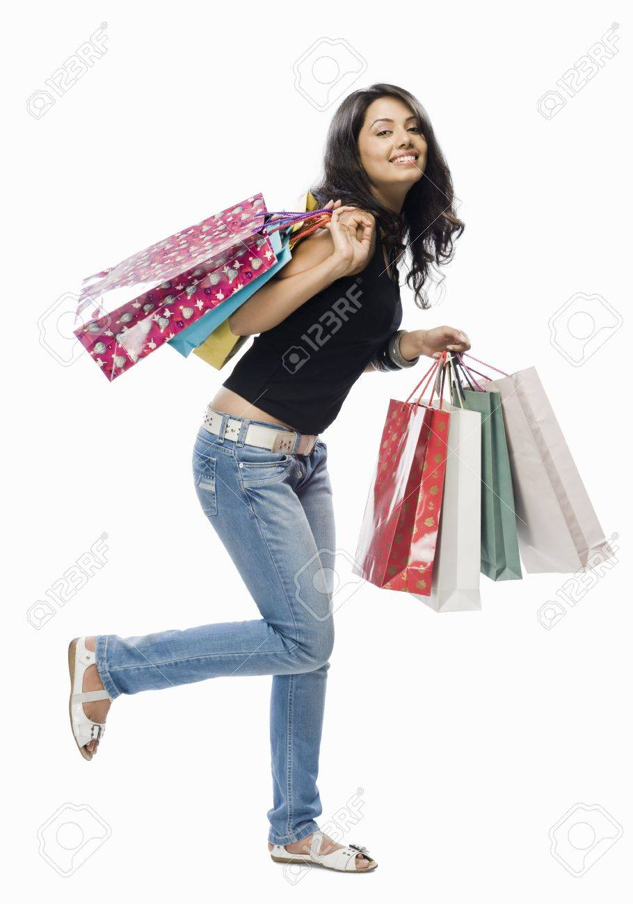 Portrait of a young woman holding shopping bags Stock Photo - 10123568