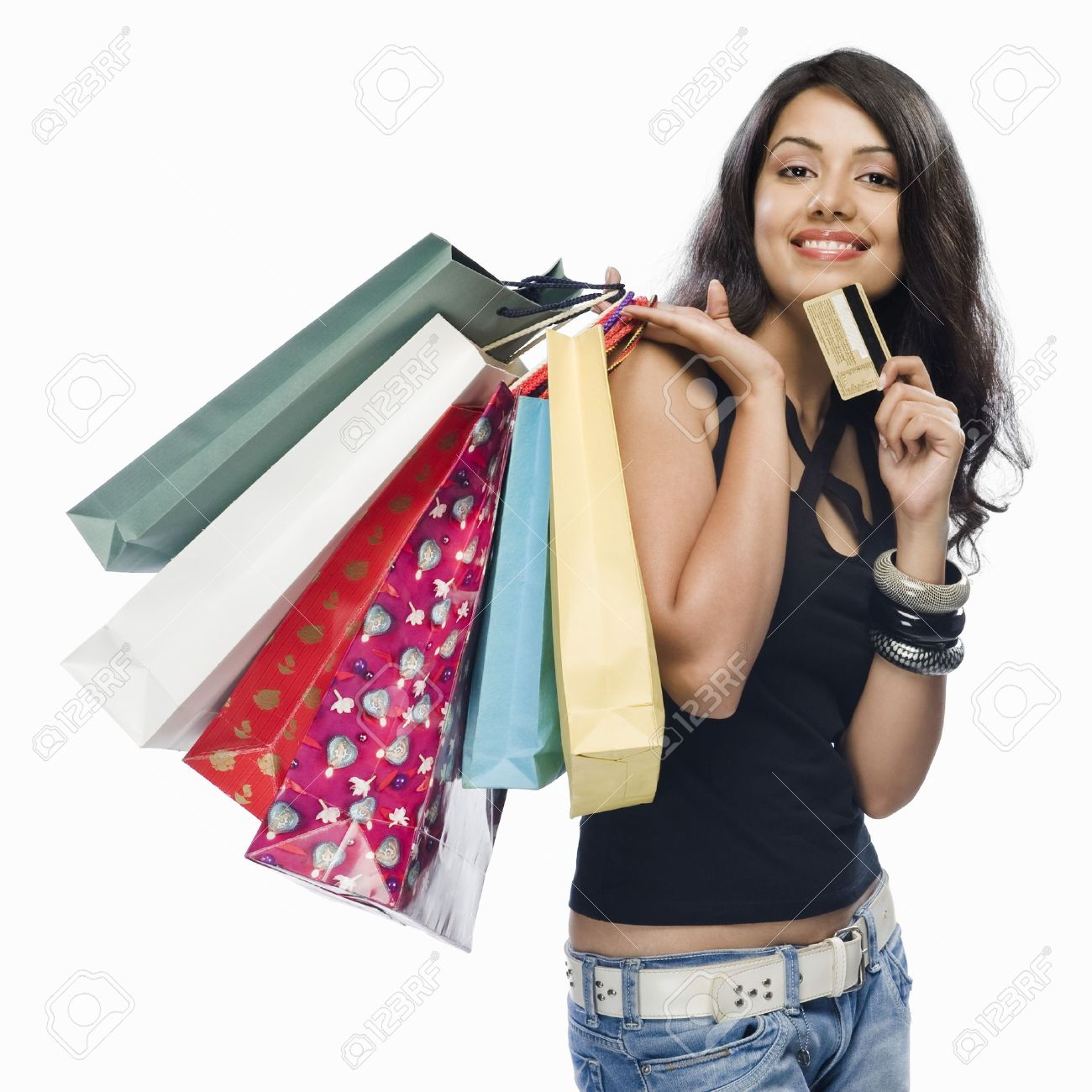 Portrait Of A Young Woman Holding Shopping Bags And A Credit ...