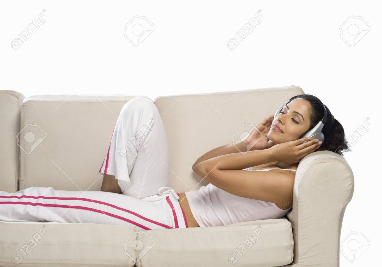 Young woman listening to music Stock Photo - 10126097