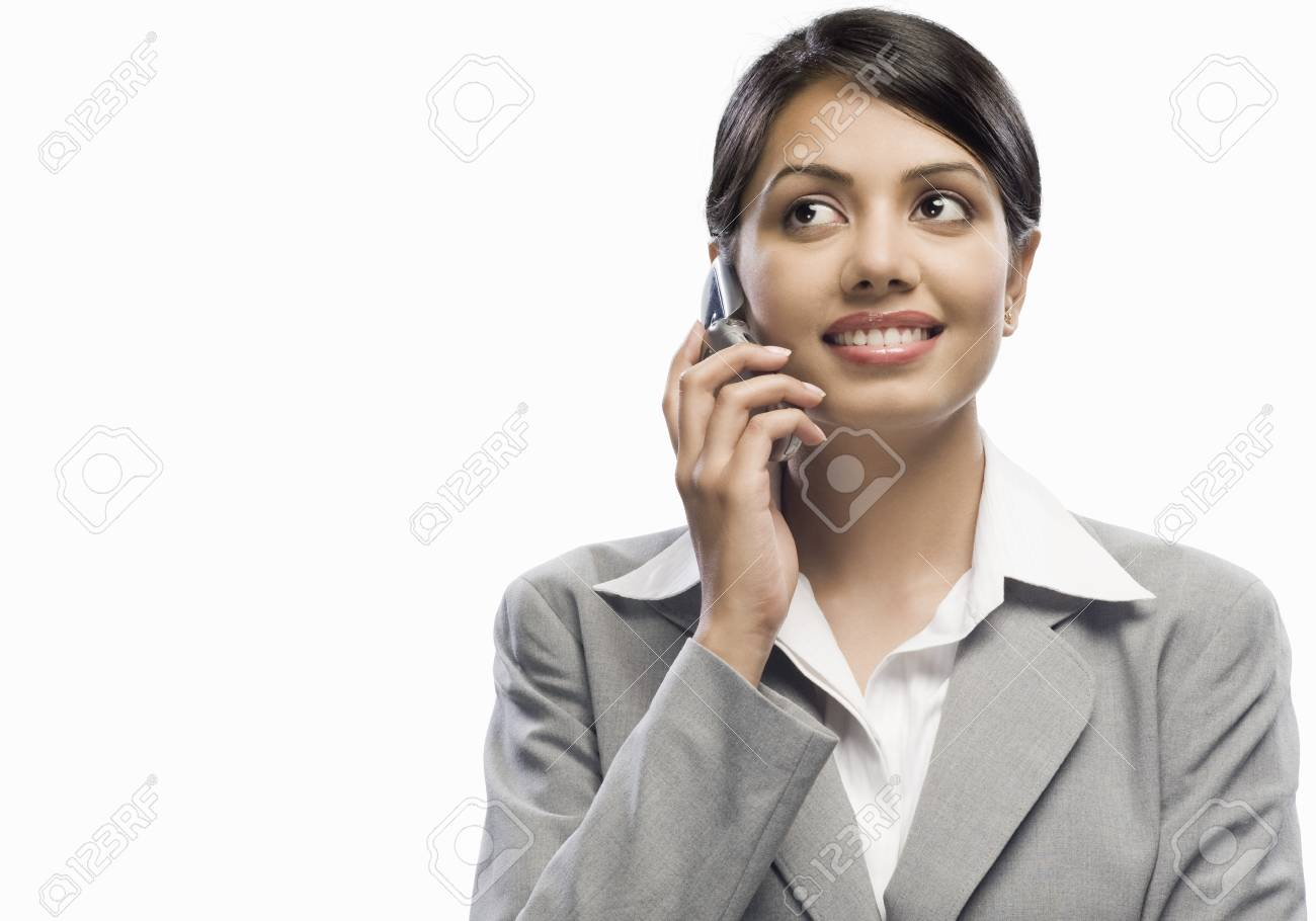 Businesswoman talking on a mobile phone against a white background Stock Photo - 10123652