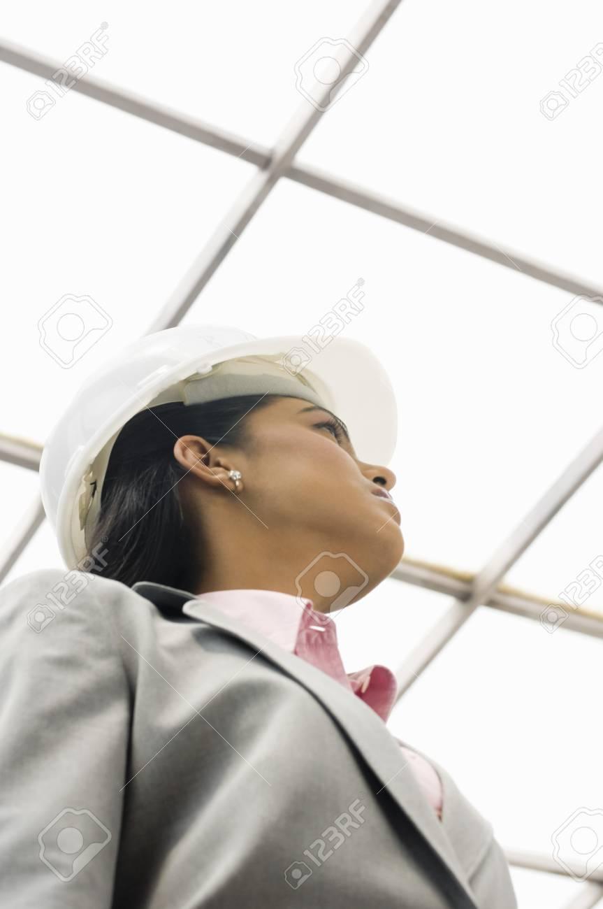 Female architect looking up Stock Photo - 10123486