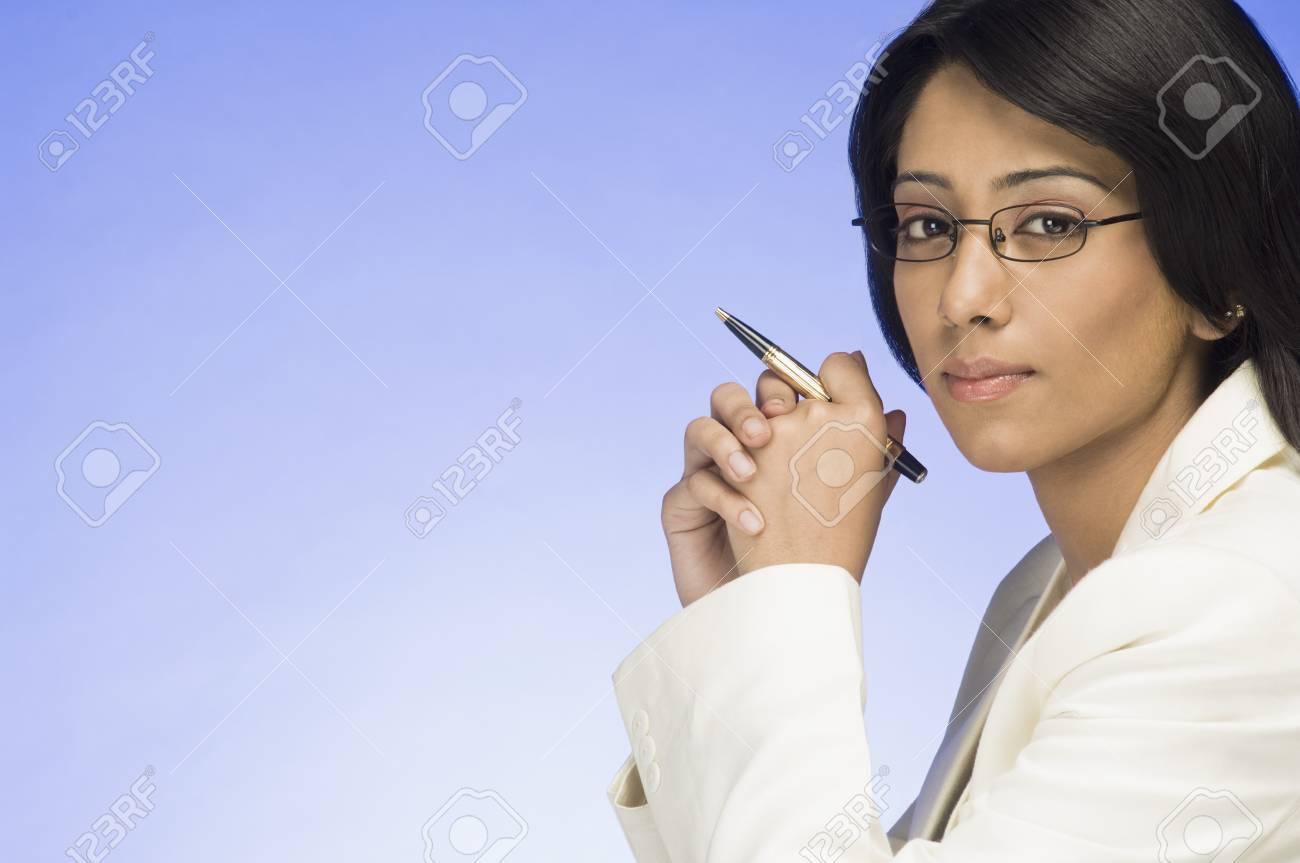 Portrait of a businesswoman holding a pen Stock Photo - 10126193