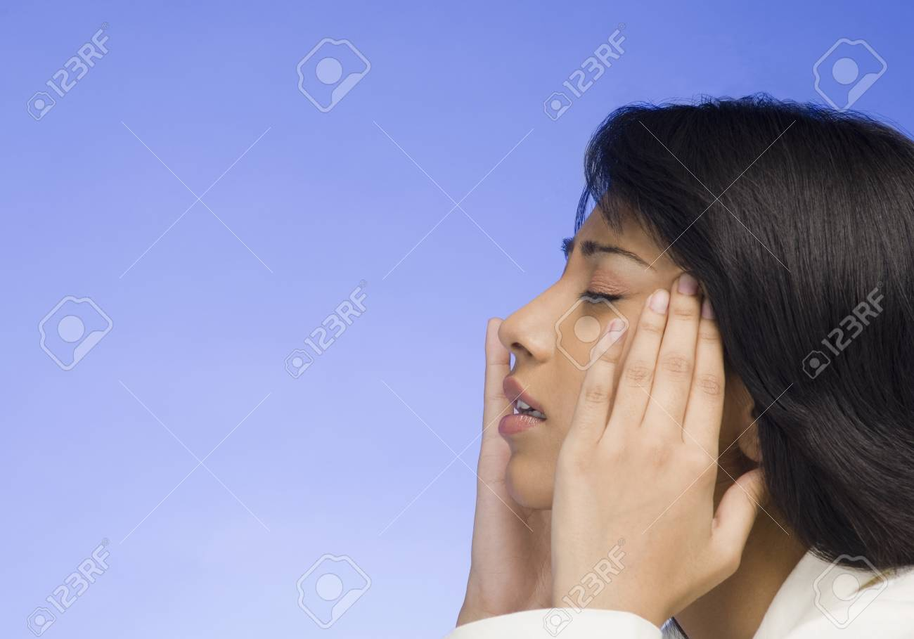 Frustrated businesswoman with her head in her hands Stock Photo - 10126149
