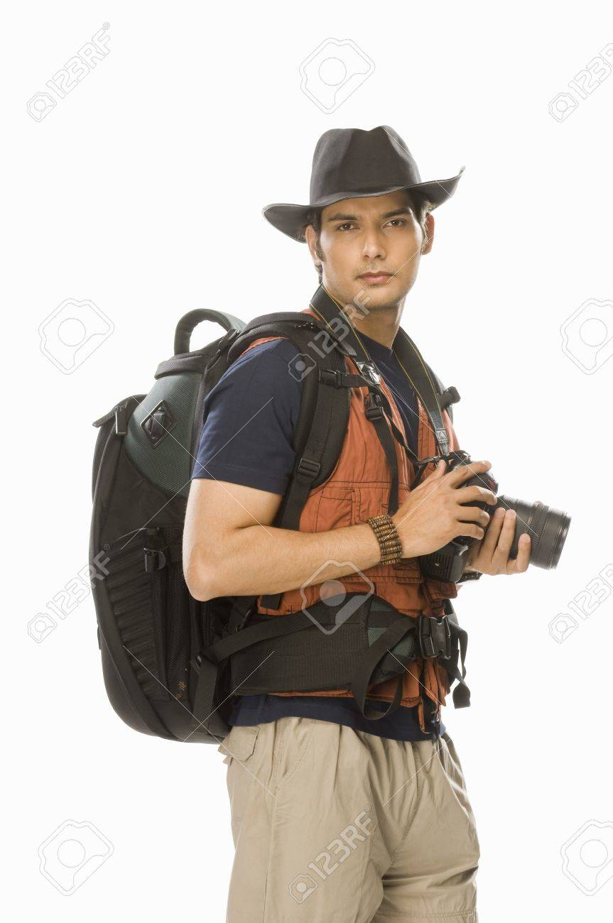 Portrait of a young male photographer holding a digital camera Stock Photo - 10123608