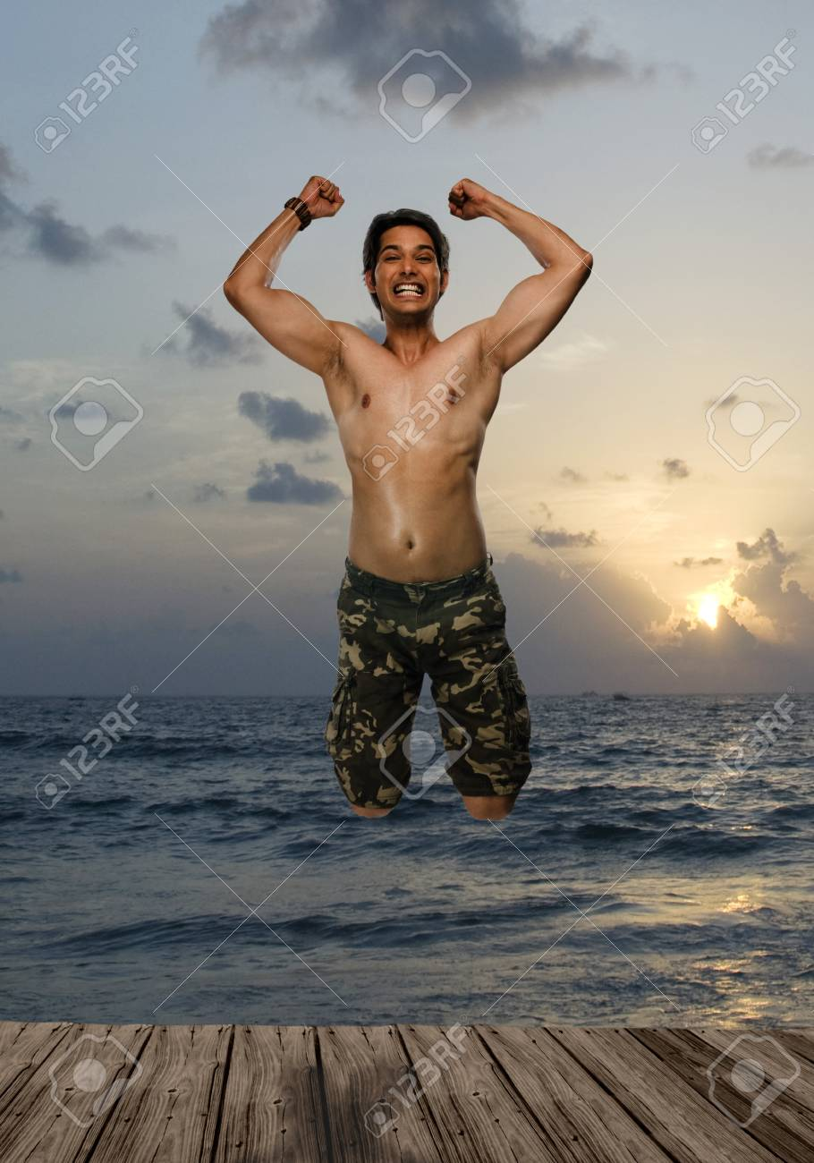 Portrait of a young man jumping with joy Stock Photo - 10123754