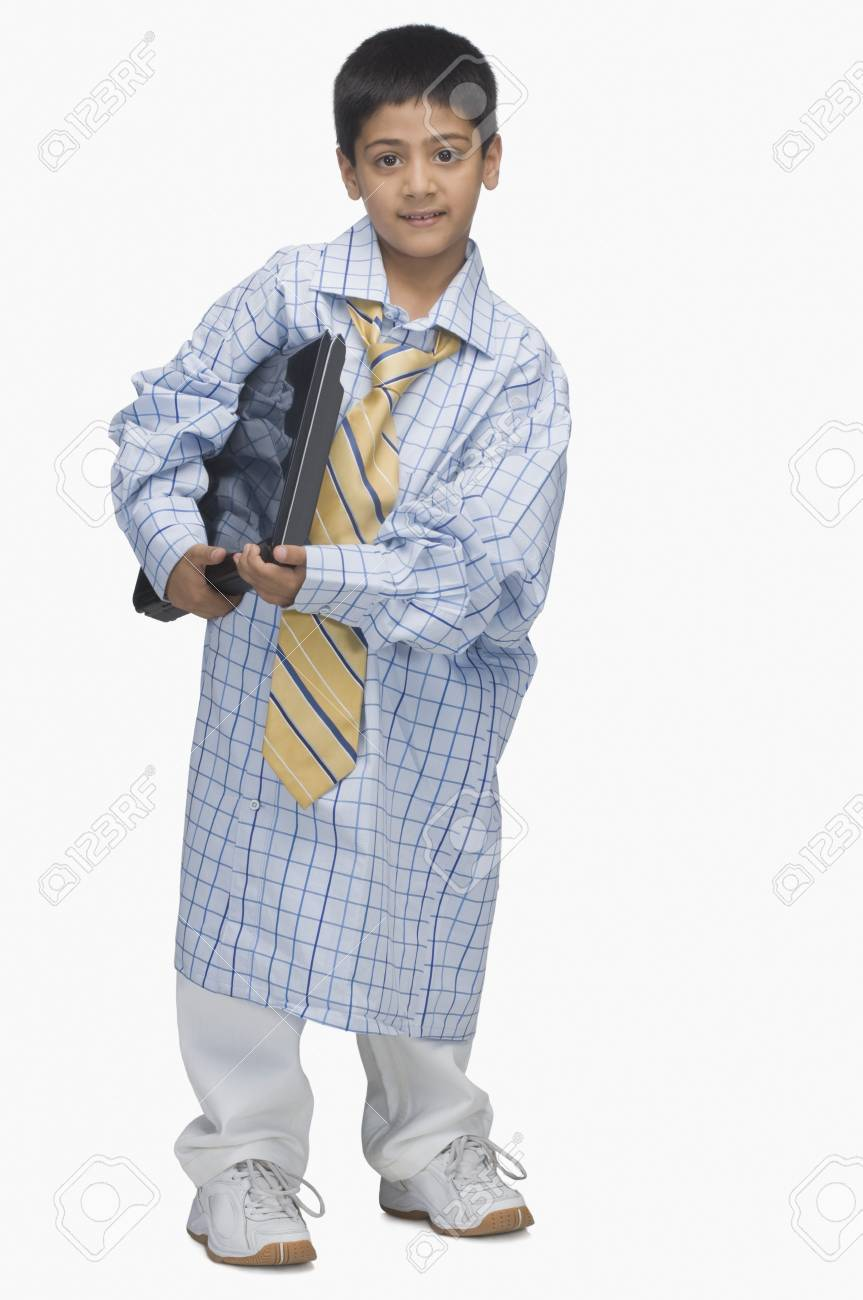 Portrait of a  boy wearing oversized shirt and holding a laptop Stock Photo - 10125470