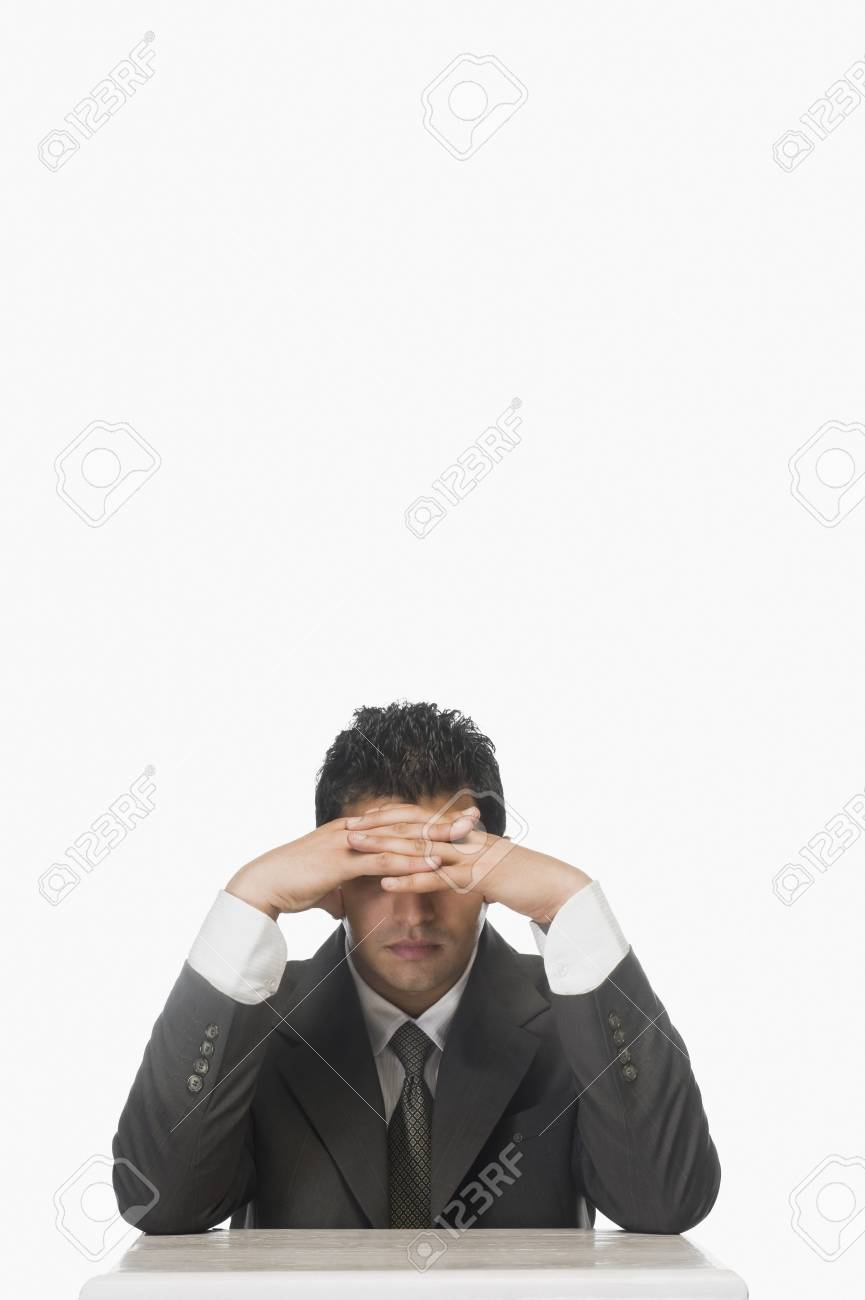 Businessman holding his forehead Stock Photo - 10123951
