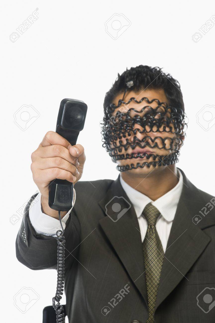 Businessman showing telephone receiver with his obscured face Stock Photo - 10124276