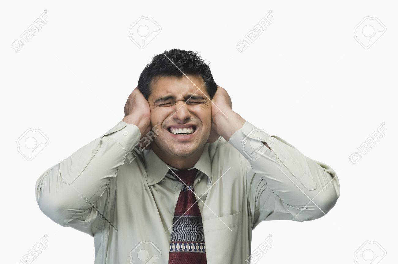 Close-up of a businessman with his hands on his ears Stock Photo - 10124233