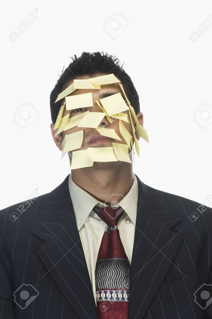 Businessman's face wrapped with adhesive notes Stock Photo - 10124649