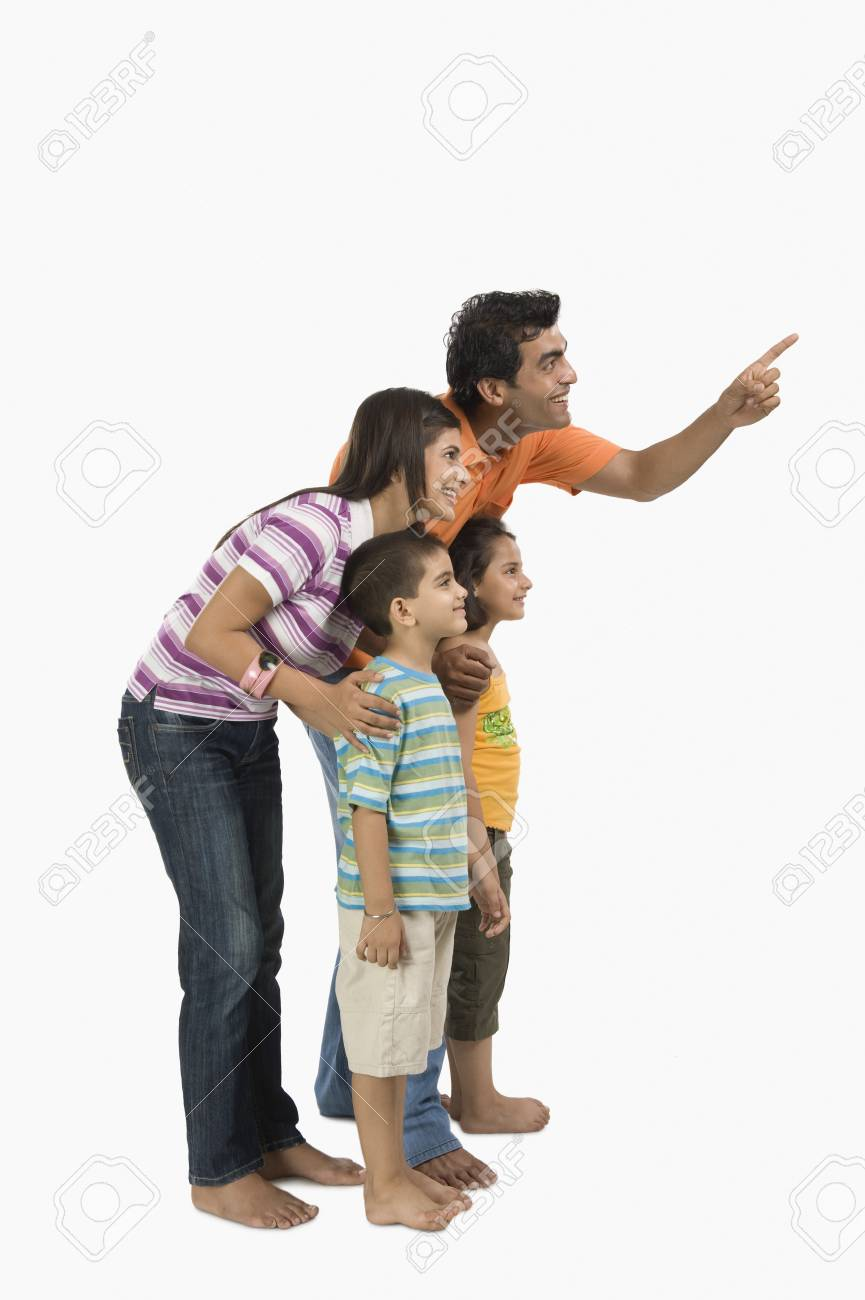 Parents standing with their children and pointing Stock Photo - 10124040