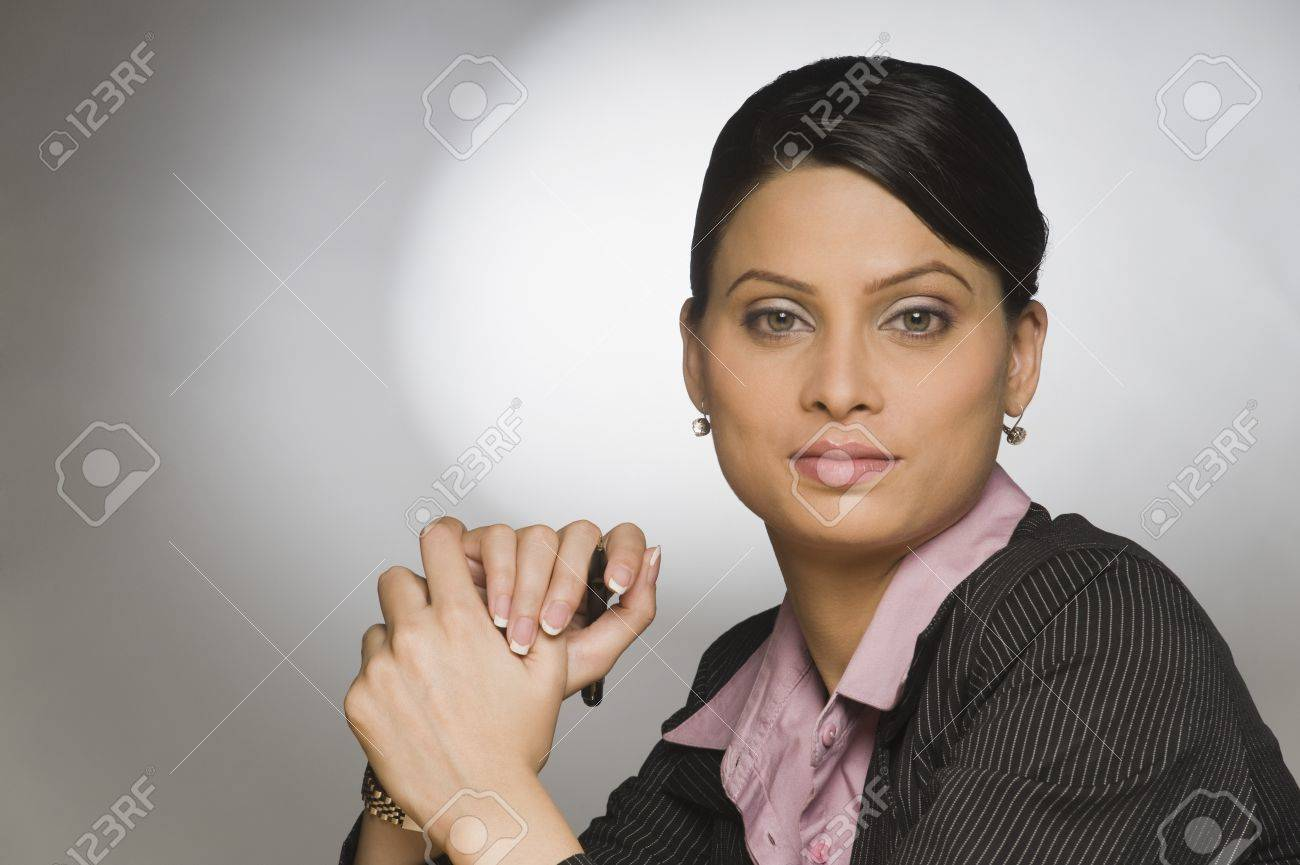 Close-up of a businesswoman holding a pen Stock Photo - 10166407