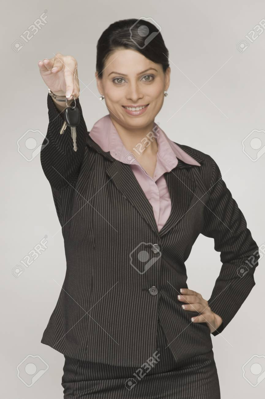 Close-up of a businesswoman showing a car key Stock Photo - 10166598