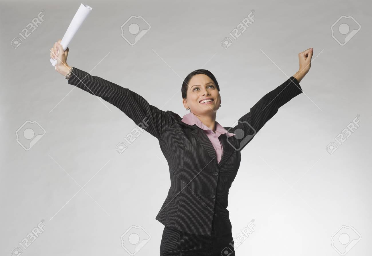 Businesswoman smiling with her arms raised Stock Photo - 10124511