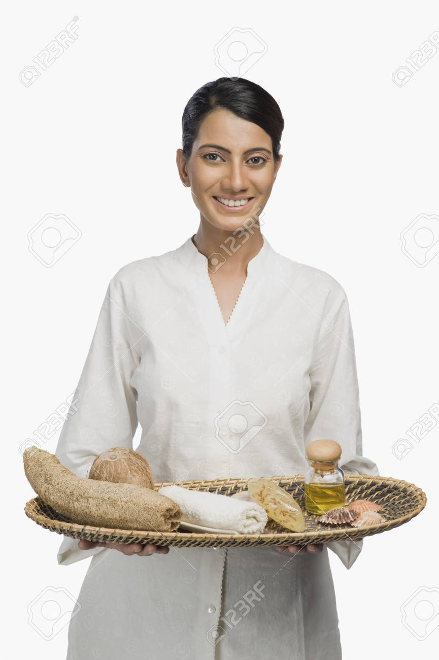 Woman holding a tray of products for aromatherapy Stock Photo - 10125437