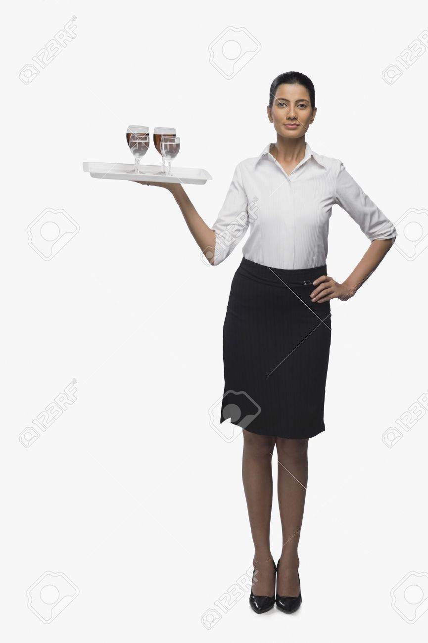 Air hostess carrying a tray of wine glasses Stock Photo - 10123853