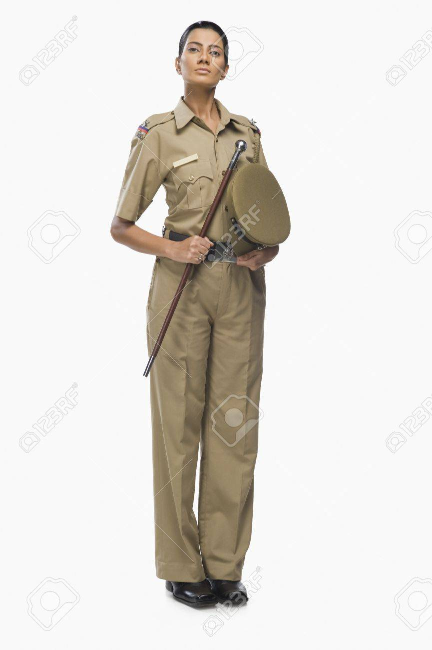 Portrait of a female police officer holding a stick Stock Photo - 10123916