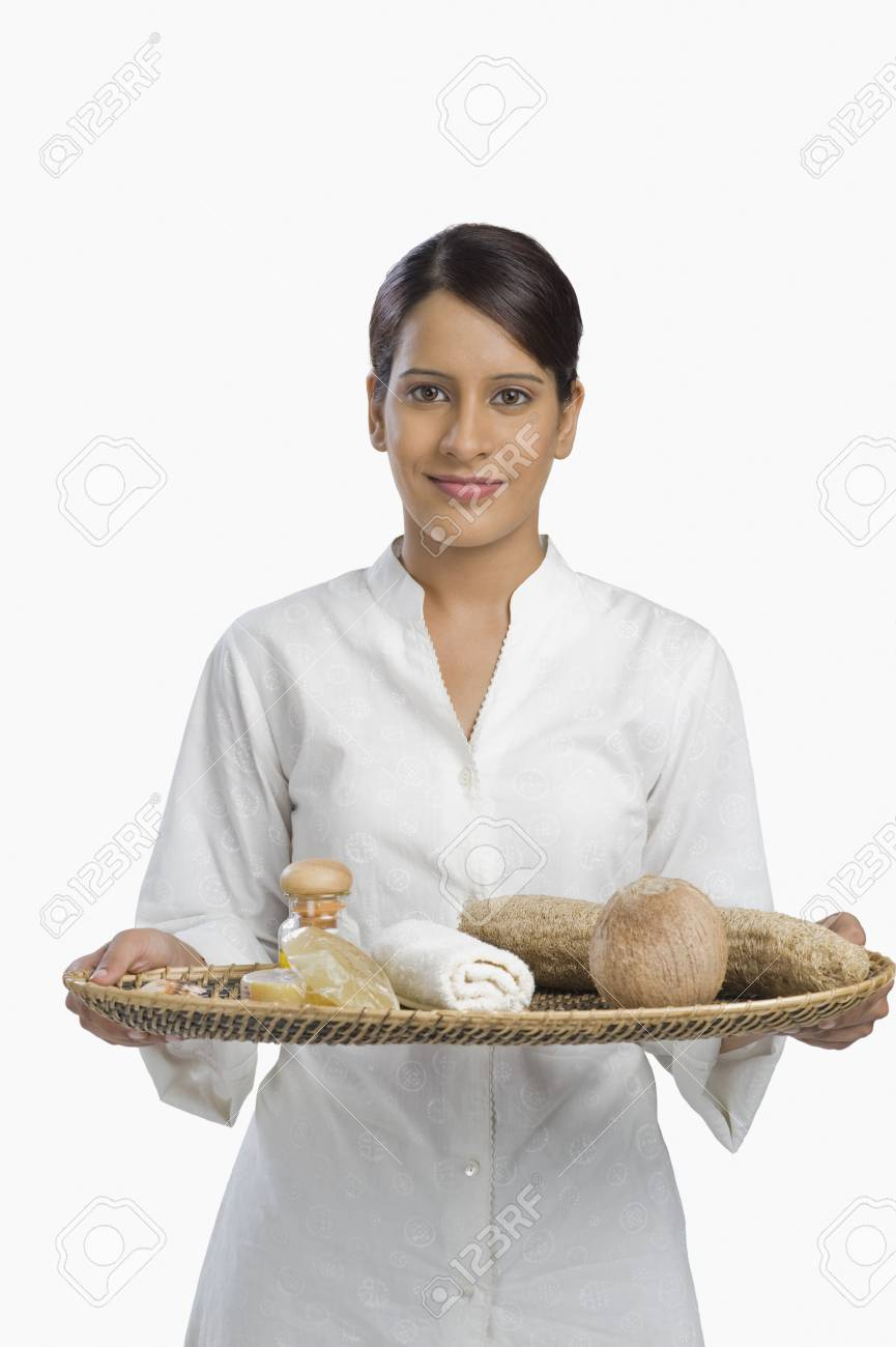 Woman holding a tray of products for aromatherapy Stock Photo - 10124152