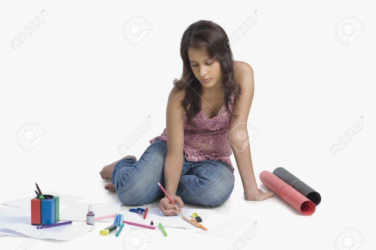 Female fashion designer sketching a dress Stock Photo - 10124097