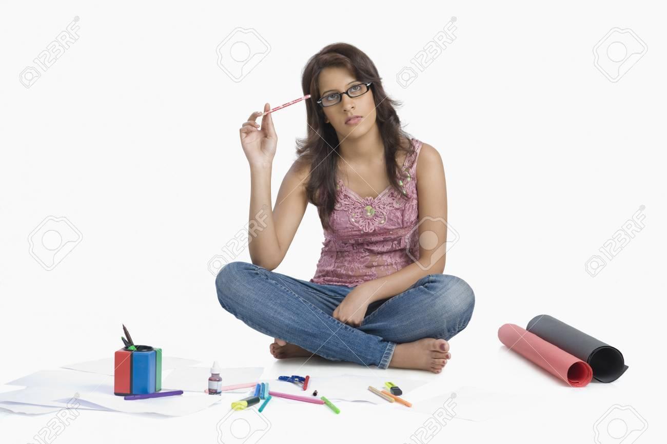 Female fashion designer sketching and thinking Stock Photo - 10124167
