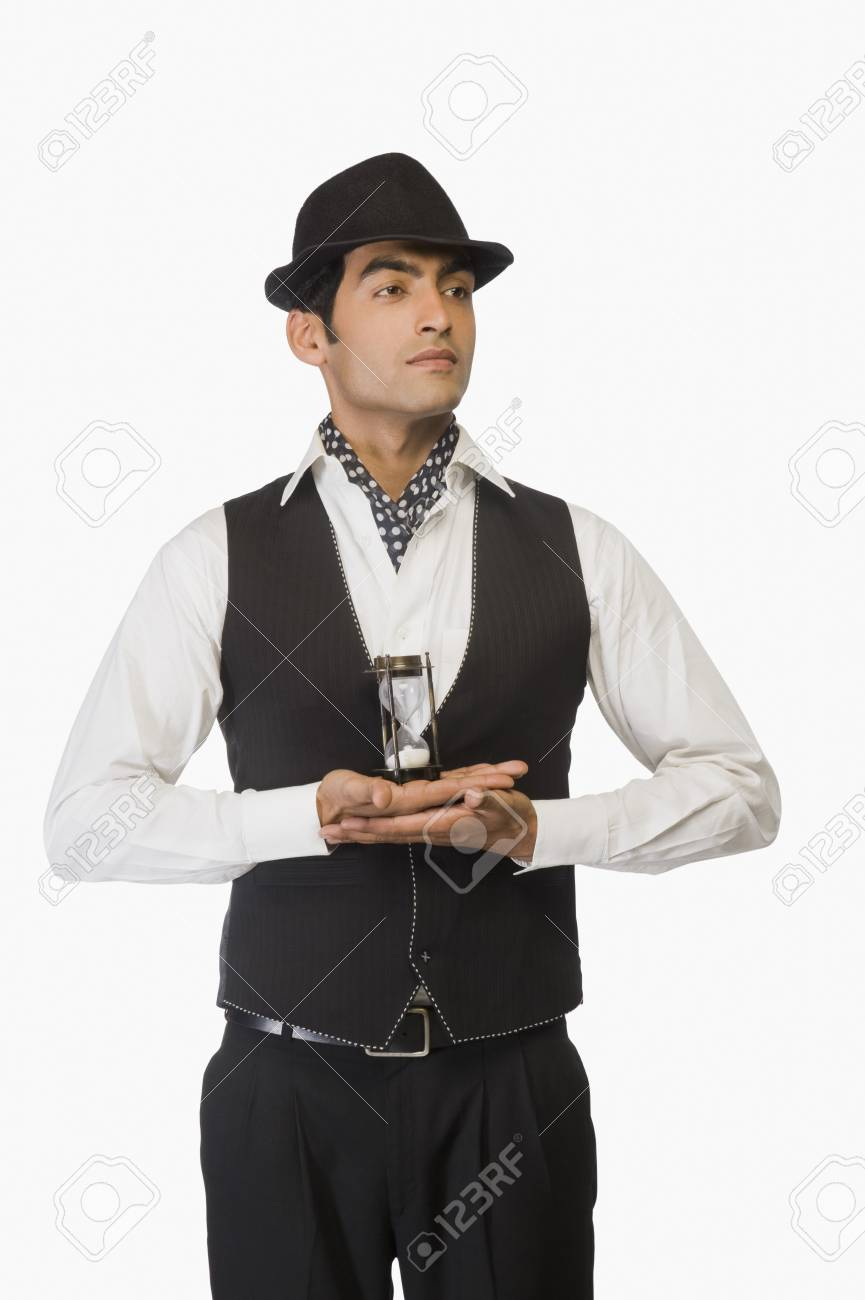 Businessman holding an hourglass Stock Photo - 10124110