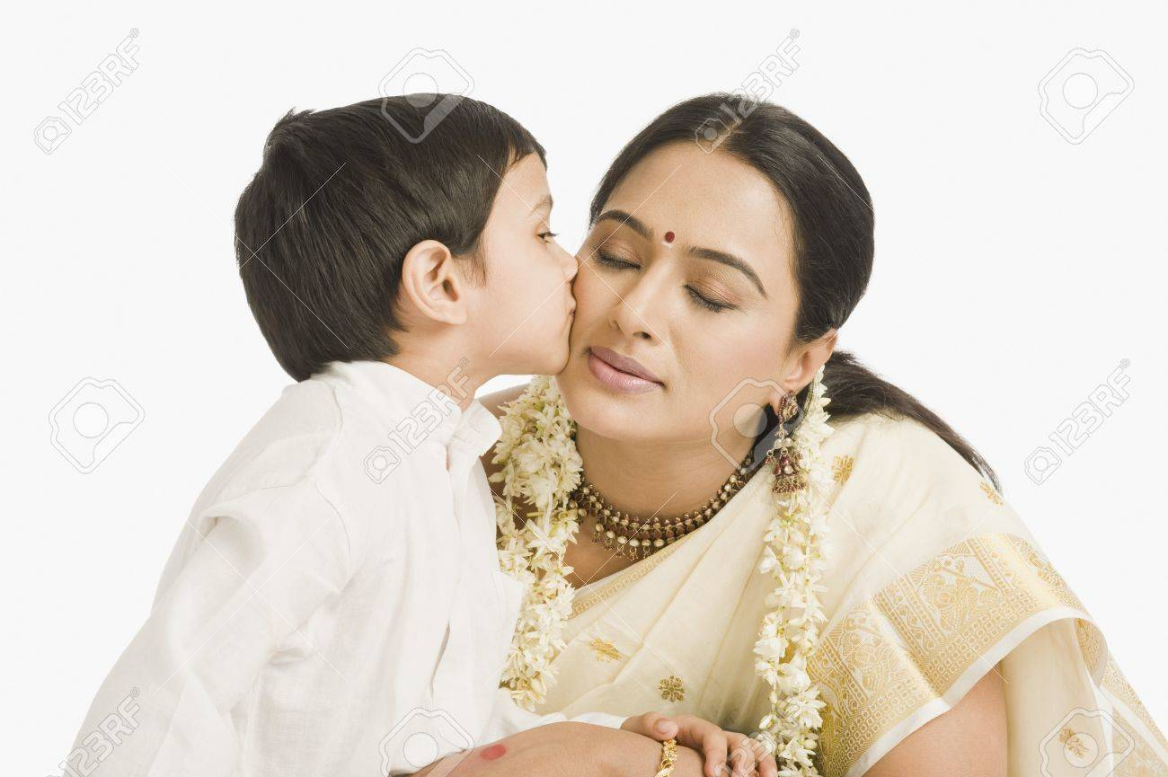 Boy kissing his mother Stock Photo - 10124779