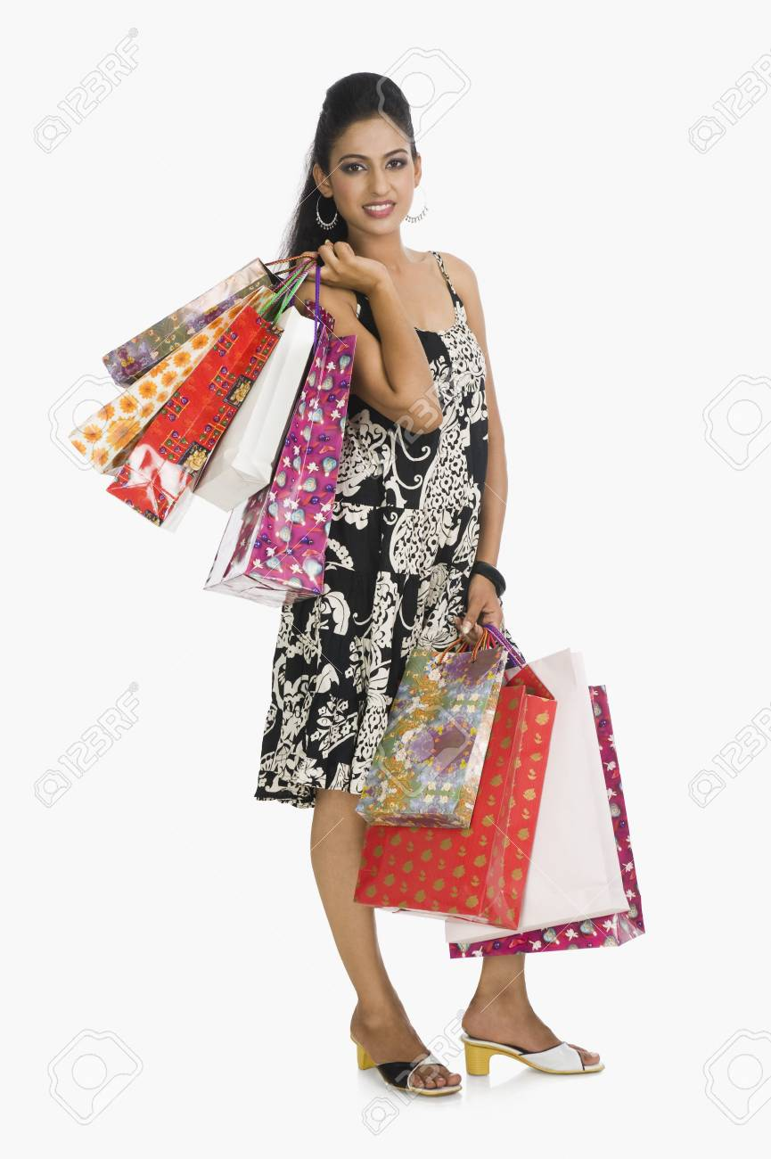 Woman carrying shopping bags Stock Photo - 10125344