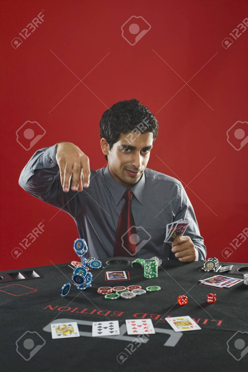 Portrait of a man gambling in a casino Stock Photo - 10166492
