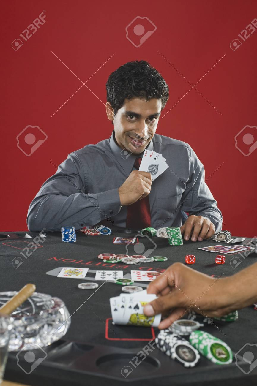 Portrait of a man gambling in a casino Stock Photo - 10169198
