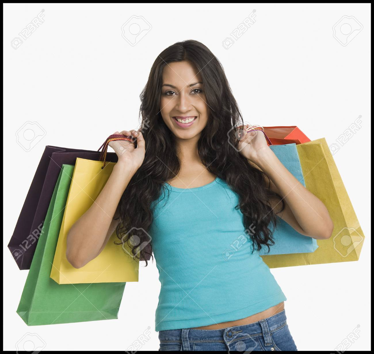 Woman carrying shopping bags Stock Photo - 10166248